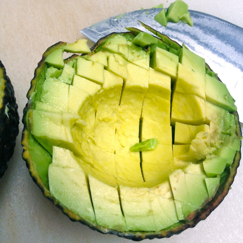 Score avocado as directed, so 'Queso' fills the space