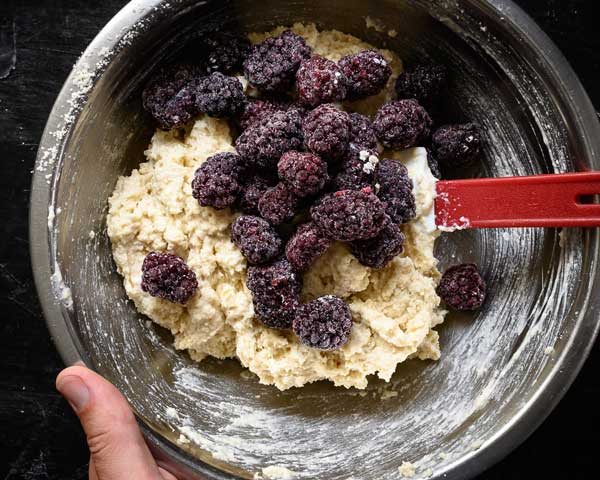 Adding blackberries to the scones