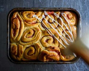 glazing on rhubarb cinnamon rolls