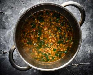 green lentil spinach dal cooking