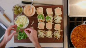 assembling jackfruit BBQ sliders with cilantro